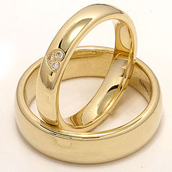 Klassische Herz trauringe aus 14 Karat Gold 0,03 ct - set